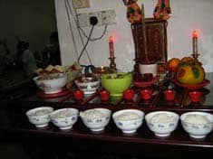 Offering to ancestors on home altar: Public Domain