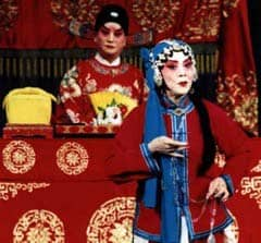 Confucian official presiding over scene in Chinese opera: Public Domain