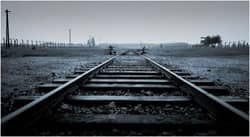 Tracks at Auschwitz-Birkenau: photo courtesy of Greenwich Photography via C.C. license at Flickr