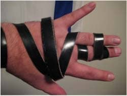The Ashkenazi way to wrap the tefillin straps on your hand, forming the Hebrew letter Shin (ש) over the hand. Photo by Yonkeltron via Wikimedia CC
