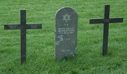 Title: Jewish tombstone between two Christian grave markers  Source: http://www.flickr.com/photos/ilesdelamadeleine/2555976376/