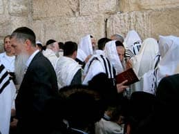 Title: Orthodox Jewish men praying in a segregated manner (Western Wall in Jerusalem) Source: http://www.flickr.com/photos/andydr/3442861552/